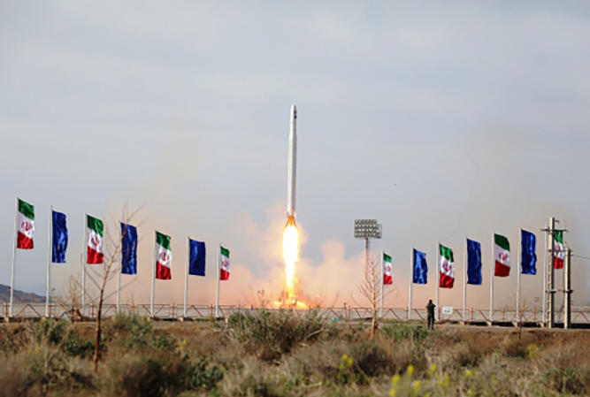 Iranians launch a rocket carrying a satellite