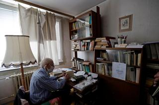 Petr Brandejsky, a 90-year-old Holocaust survivor, reads a book at his apartment during coronavirus outbreak in Prague