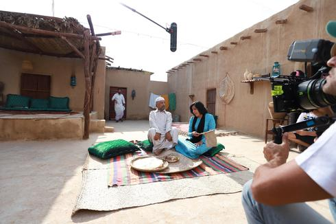 Omani actor Fakria Khamis (R) and Kuwaiti actor Mohammed Jaber (L) are seen at a shooting set during filming of MBC's ramadan Arabic series 'Umm Haroun' in Dubai