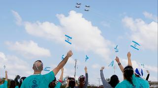 Medical teams wave at a flyby in their honor outside the Sheba Medical Center near Tel Aviv