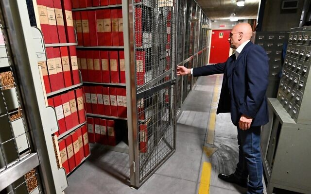 An attendant opens the section of the archive dedicated to Pope Pius XII