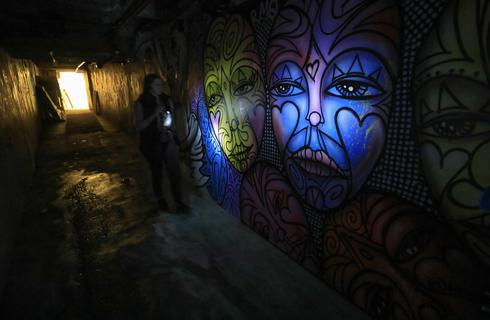 A woman makes her way through the VIP underground corridor at the premises of the former Pussycat strip club