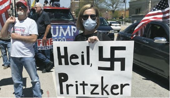 Anti lockdown protesters holding antisemitic signs in Illinois
