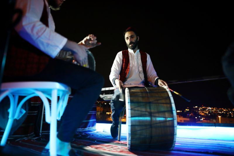 A festive Ramadan float play music as it drives through a street in East Jerusalem
