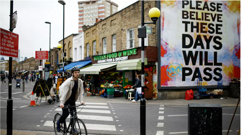 A cyclist at Broadway Market in London
