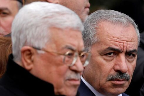 Palestinian Prime Minister Mohammad Shtayyeh and President Mahmoud Abbas attend the funeral of former senior Fatah official Ahmed Abdel Rahman, in Ramallah
