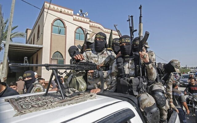 Palestinian Islamic Jihad terrorists attend the funeral of a fellow fighter in Khan Younis in the southern Gaza Strip