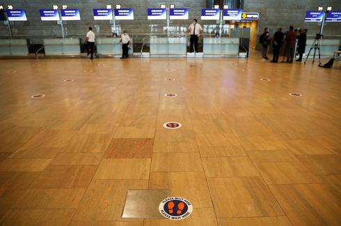 A social distancing marker is seen on the floor at the departures terminal at Ben Gurion Airport