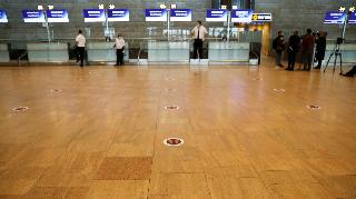 A social distancing marker is seen on the floor at the departures terminal at a near-deserted Ben Gurion Airport