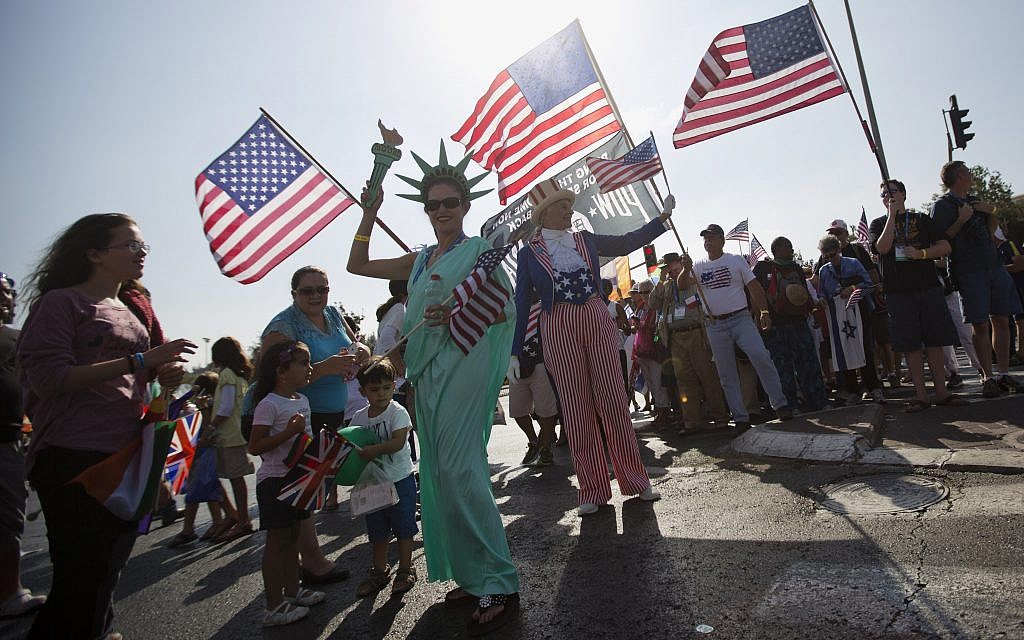 Evangelical Christians from various countries wave flags as they march to show their support for Israel in Jerusalem