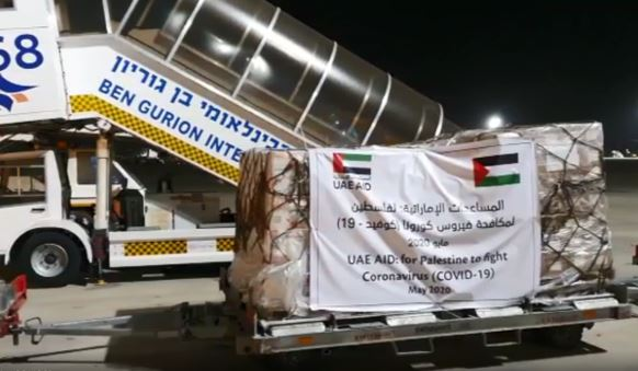 Cargo from the UAE is taken off a Etihad Airways flight to Ben-Gurion Airport on Tuesday