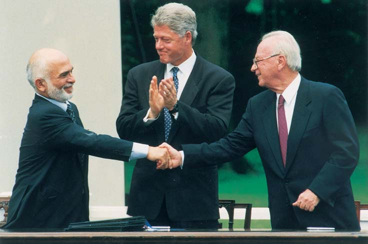 King Hussein of Jordan, U.S. President Bill Clinton and Prime Minister Yitzhak Rabin at the signing of the bilateral peace treaty at the White House, July 25, 1994