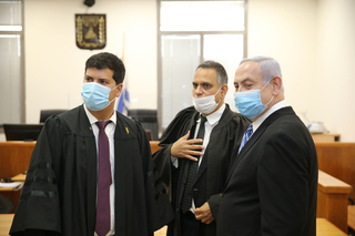 Prime Minister and his legal team at a hearing on his corruption charges at the Jerusalem Magistrates' Court