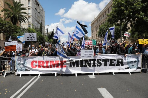 Netanyahu opponents protest outside the Prime Minister's Residence in Jerusalem, May 24, 2020