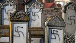 A Jewish cemetery is defaced with swastikas