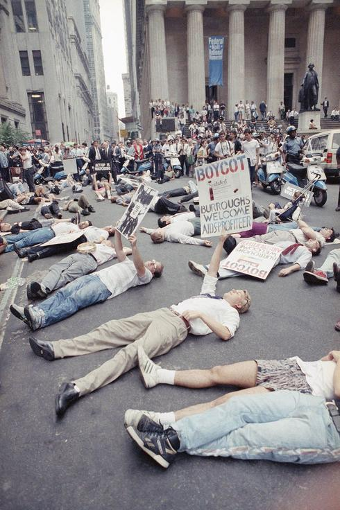 Demonstrators in front of the New York Stock Exchange in 1989 protesting the high cost of the AIDS drug AZT. The protest was organized by the militant group Act Up, of which Mr. Kramer was a founder