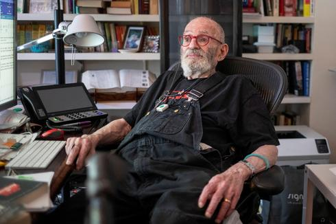 Larry Kramer poses for a portrait in his apartment in New York