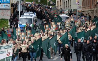 Far-right and neo-Nazi supporters walk through Plauen in eastern Germany