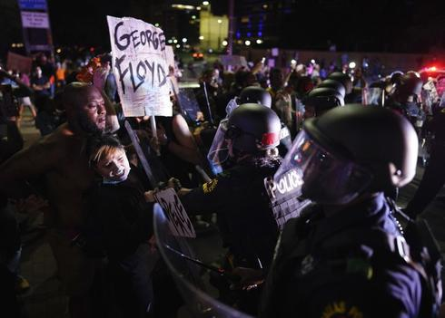 Protesters clash with Dallas police at Griffin and Young on Friday, May 29, 2020, in Dallas