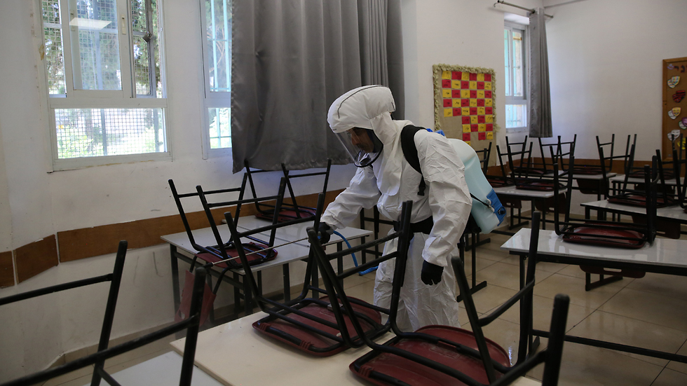 Disinfecting a Jerusalem school at the center of an outbreak of the virus