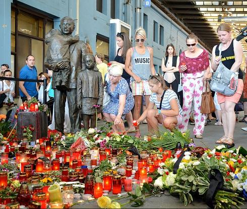 Tributes are laid at the statue of Sir Nicholas Winton in Prague train station following his death in 2015