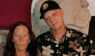 Michael White poses with mother Joanne in undated family photo