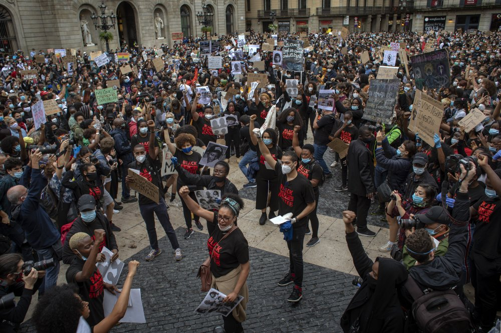 People gather in Barcelona, Spain, during a demonstration over the death of George Floyd