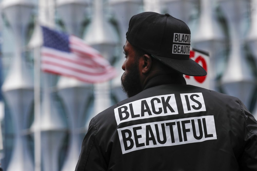 A protester stands in front of the US embassy during the Black Lives Matter protest rally in London