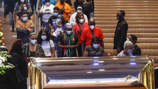 People file by coffin of George Floyd murdered by police