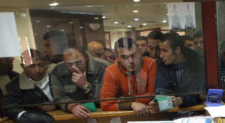 Palestinian Authority employees wait to be paid in the northern West Bank city of Jenin,