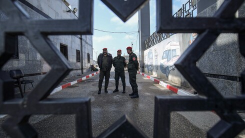 Palestinian security forces loyal to Hamas stand at the Rafah border crossing with Egypt in the southern Gaza Strip