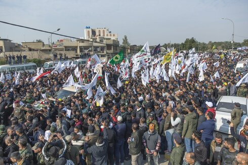 Mourners march during the funeral of Iran's top general Qassem Soleimani, and Abu Mahdi al-Muhandis, deputy commander of Iran-backed militias in Iraq known as the Popular Mobilization Forces and fellow militant leaders, in Baghdad, Iraq