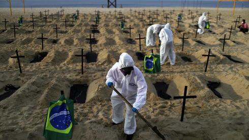 Teams dig graves on the beach in Brazil for coronavirus victims