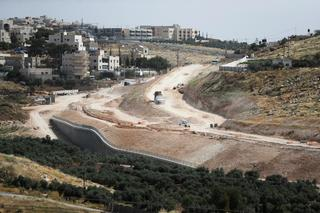 An aerial view shows a section of The American Road, an Israeli ring road being built near the Palestinian neighbourhood of Umm Tuba in East Jerusalem