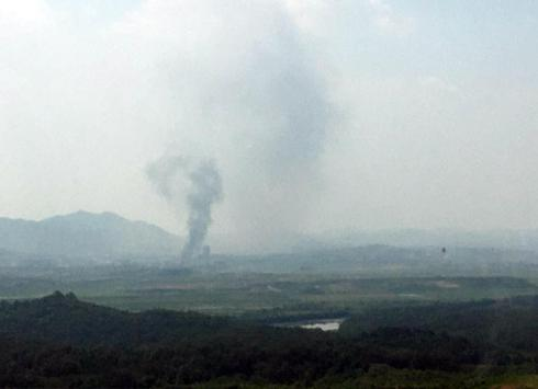 Smoke rise from North Korea's Kaesong Industrial Complex where an inter-korean liaison office was set up in 2018, as seen from South Korea's border city of Paju