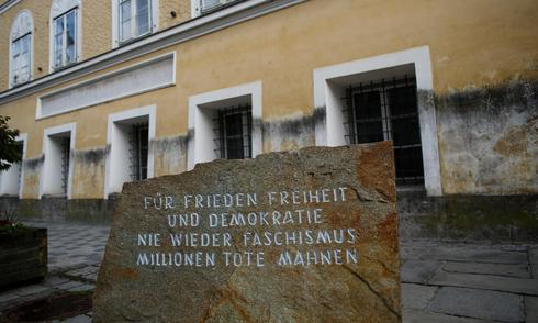A memorial stone outside the house in which Adolf Hitler was born bears the inscription: 'For peace, freedom and democracy, never again fascism, millions of dead are a  warning'