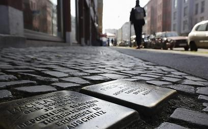 Rosa-Luxemburg Street in Berlin is paved with 'Stolpersteine' to remember the victims of the Holocaust