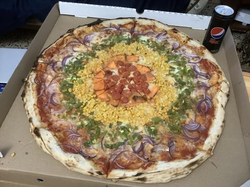 Pride Pizza, featuring vegetables in the colors of the rainbow flag, from PizzaPil in Tel Aviv