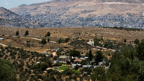 The West Bank settlement of Itamar, with Nablus in the background
