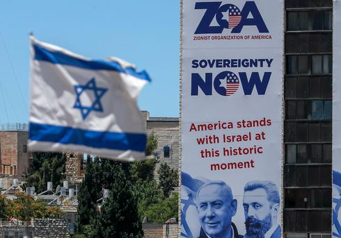 A street sign placed in Jerusalem by the Zionist Organisation Of America expresses support for Israel's plan to annex parts of the West Bank, June 2020