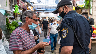 Mask mandate being enforced in Jerusalem at the onset of the pandemic