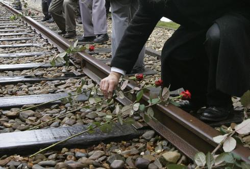 Roses are symbolically placed on the railroad tracks at former concentration camp Westerbork, the Netherlands