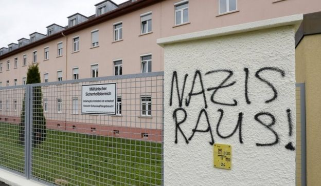"""Graffiti reading """"Nazis out!"""" on a fence at the Fürstenberg barracks in Donaueschingen"""