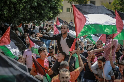A Palestinian demonstrator shouts slogans as he takes part in a protest against Israel's annexation plan, July 1, 2020