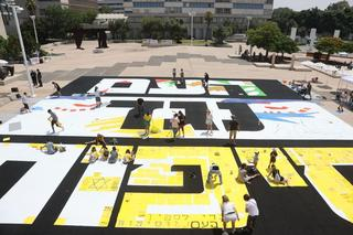 Protesters decorate the words 'The nation against annexation' outside Tel Aviv Museum of Art on Saturday