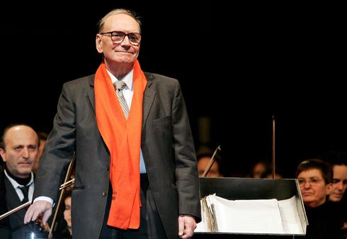 Italian movie composer Ennio Morricone conducts the Sinfonietta orchestra during a Christmas concert in Milan December 16, 2006