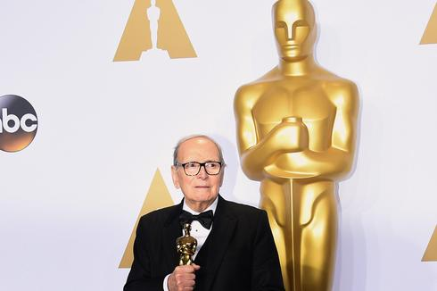 Ennio Morricone with the Oscar for Best Original Score award for 'The Hateful Eight'