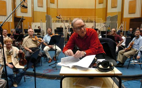 Italian composer Ennio Morricone (C) instructs musicians as he conducts the Symphonic Orchestra of the Hungarian Radio during the recording the soundtrack of the film 'Fateless'