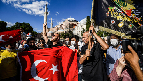 Turks celebrate the decision to transform the Hagia Sophia in Istanbul into a mosque