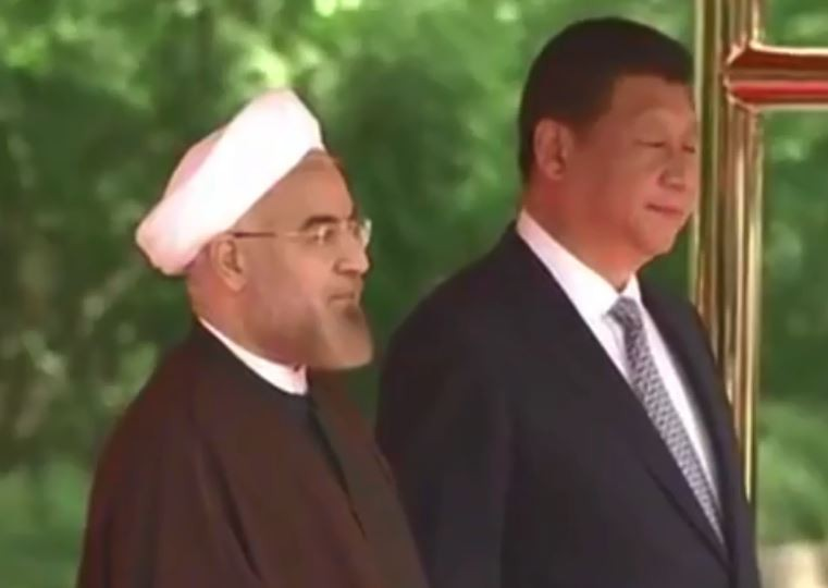 Chinese President Xxi Jinping and his Iranian counterpart Hassan Rouhani